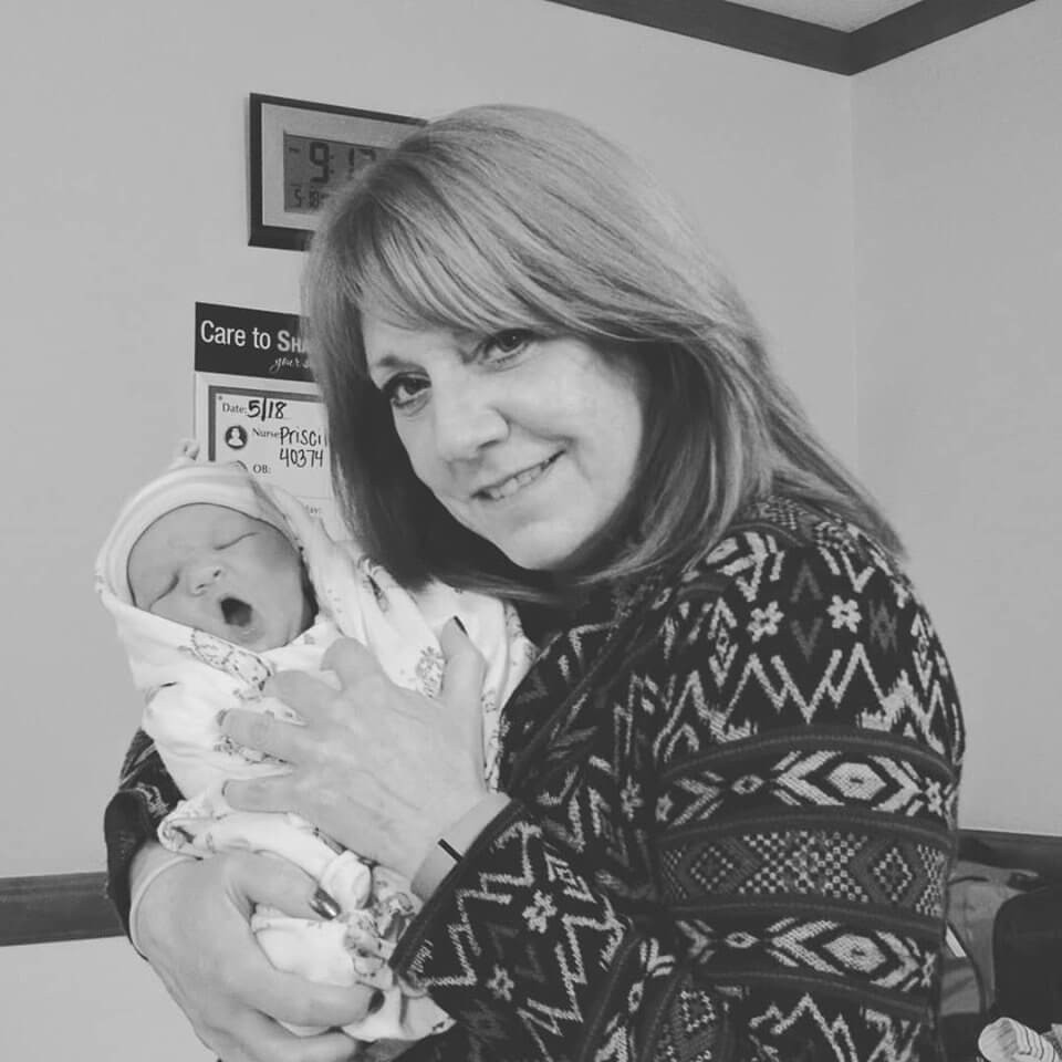 With one of my precious grand babies right after the birth.