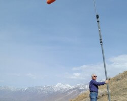Facing into a 40 mph wind, hang gliding point above the Bonneville Shoreline Trail, March 2021